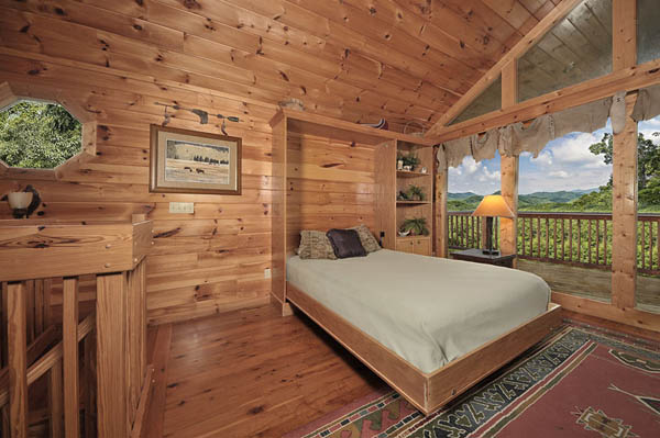 Hideaway murphy bed on the upper level of Cherokee Sunset, awaken to views of the Smoky Mountains.