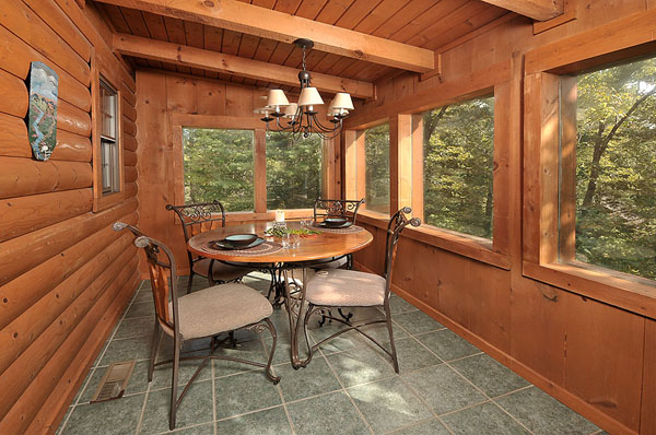Serenity Now!! cabin - Glassed in and air conditioned, tiled sun porch, dining area and table with seating for four.