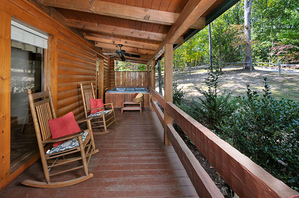 Serenity Now!! cabin - View of front Deck with the hot tub showing the porch and rockers. Relax in the rocking chairs on the front deck, or sit and