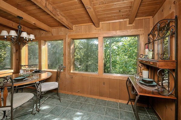 Serenity Now!! cabin - You may enjoy sitting and reading the morning paper on this glassed-in, air-conditioned, tiled sun porch...