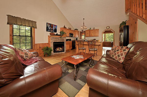 Serenity Now!! cabin - Beautiful leather furniture and coffee table in the living room with Stone gas fireplace.