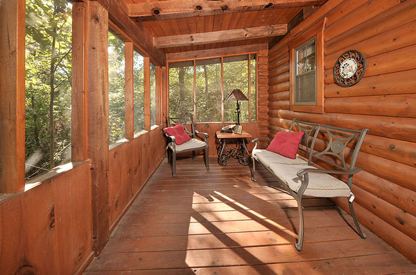 Serenity Now!! cabin - Serenity Now!! Screened deck with deck furniture on the back of the cabin over looking huge back yard, lots of privacy.
